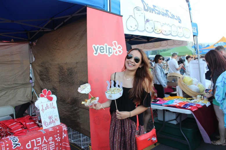 Here's me at the Yelp booth! I checked my location at Night It Up! through their mobile app, we chilled, got free goodies, and took pics with these cute signs the girl working made!